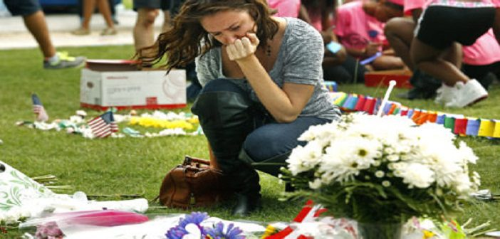ORLANDO, FLORIDA - JUNE 13: Danielle Irigoyen brings flowers to the victims of the Puls nightclub shooting.