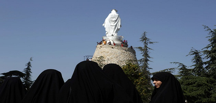 Lebanese Muslim Shiite women members of of Hezbollah's al-Mehdi movement visit a church at the shrine of Our Lady of Lebanon in the town of Harissa north east of the Lebanese capital Beirut, marking the start of the Holy Month of Virgin Mary, on May 1, 2016.Virgin Mary is considered one of the most righteous and greatest women in Islam and is venerated by both Islam and Christianity. / AFP / PATRICK BAZ (Photo credit should read PATRICK BAZ/AFP/Getty Images)